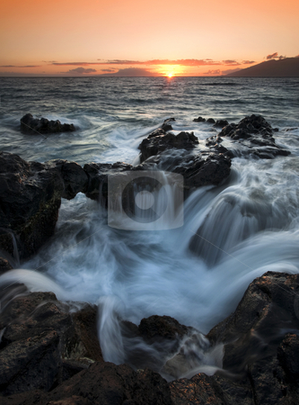 Influx stock photo, An Influx of wate from above and below into a natural cauldron formed by lava rock off the coast of Kihei, Hawaii at sunset by Mike Dawson