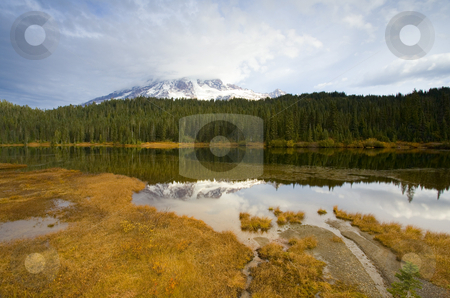 Rainier Autumn stock photo, Mt. Rainier under stormy autumn skies and reflected in the still waters of Reflection Lake by Mike Dawson
