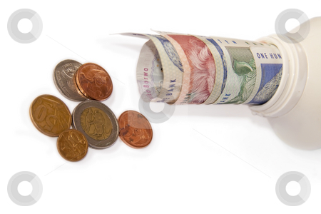 Money in a bottle stock photo, South African Money isolated on a white background by Chris Alleaume