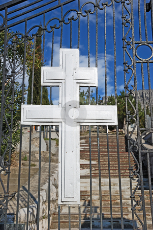 Cross at Cemetery Entrance stock photo, Cross at cemetery entrance on a sunny day. by Denis Radovanovic