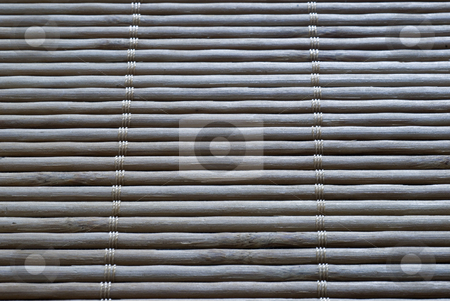 Bamboo roll  stock photo, Detail of the texture of a bamboo placemat by Stephen Gibson