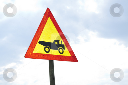 Warning sign - Vehicle stock photo, Warning road sign showing construction vehicle by Chris Alleaume