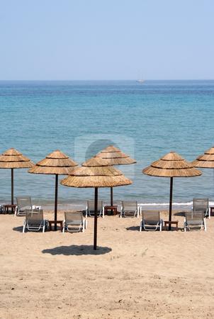 Sun Umbrellas stock photo, Thatched sun shades on a deserted beach on Zante (Zakynthos) by Helen Shorey