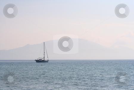 Yacht & Misty Mountain at dusk stock photo, Yacht moored in the bay of Keri, Zante, Greece by Helen Shorey