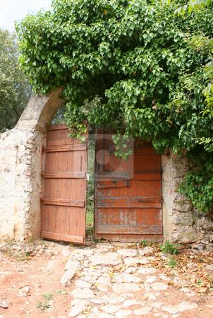 Secret garden gate stock photo, Very old gate at a ruined monastery on Zante (Zakynthos) by Helen Shorey
