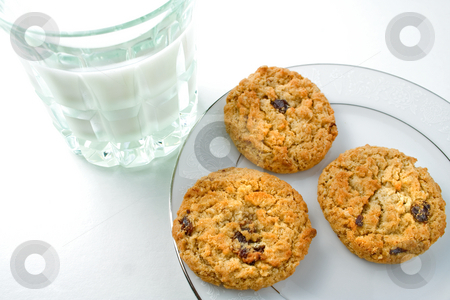 Cookies stock photo, Cookies and milk on saucer by Ira J Lyles Jr