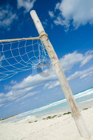 Volleyball net stock photo, Volleyball net on a empty sunny beach by Vlad Podkhlebnik