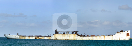 Abandonned shit stock photo, Rusty concrete abandonned ship in the middle of the ocean by Vlad Podkhlebnik