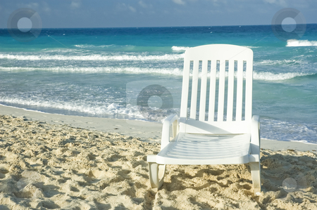 Beach stock photo, White plastic long chair on a sandy beach by Vlad Podkhlebnik