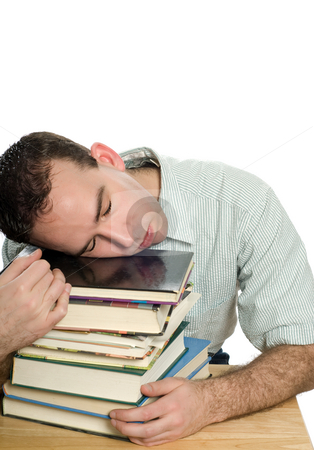 Tired Of Studying stock photo, A young man sleeping on a stack of books, isolated against a white background by Richard Nelson