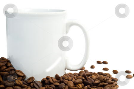 Coffee stock photo, Closeup view of a white cup and some coffee beans, isolated against a white background by Richard Nelson