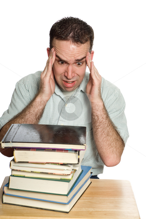 Work Headache stock photo, A man experiencing a headache from all the work he has to do, isolated against a white background by Richard Nelson