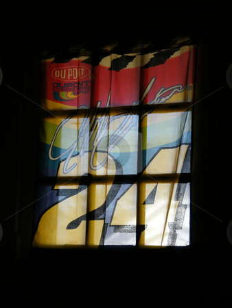 NASCAR Tapestry in a Window stock photo, Nascar Tapestry in a Window, Jeff Gordon (NASCAR driver) tapestery hanging over a entry door's window as the sunlight shines through it from outside. by Dazz Lee Photography