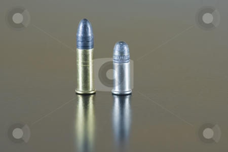 Different stock photo, Five .22 rifle rimfire cartridge, short and long, on a table by Serge VILLA