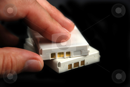 Batteries stock photo, Stock pictures of flat batteries from consumer products by Albert Lozano