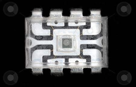 Microelectronics and chips stock photo, Close up stock pictures of the interior or a chip used in electronic devices by Albert Lozano
