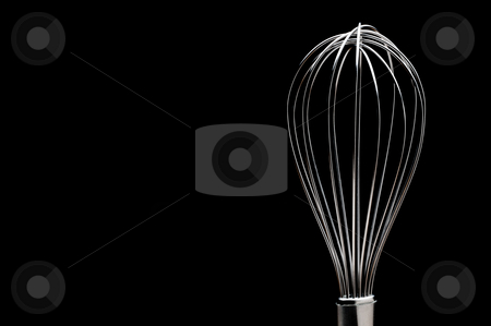 A silver stainless steel whisk on a black background stock photo, A silver stainless steel whisk on a black background by Vince Clements