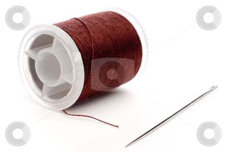 Horizontal extreme closeup of a spool of brown thread and a need stock photo, Horizontal extreme closeup of a spool of brown thread and a needle by Vince Clements