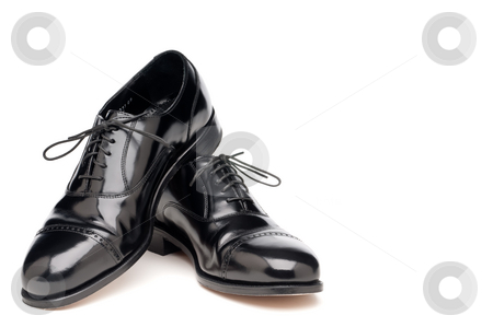 A pair of shining back dress business shoes on a white backgroun stock photo, A pair of shining back dress business shoes on a white background by Vince Clements
