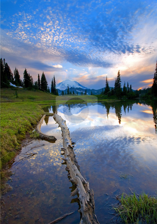 Cloud Eruption stock photo, A colorful sunset explodes over Mt. Rainier as it reflects in a small alpine lake by Mike Dawson