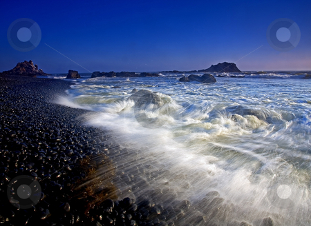 Explosive Tides stock photo, Tides explode across the stones of Cobble Beach along the Oregon Coast by Mike Dawson