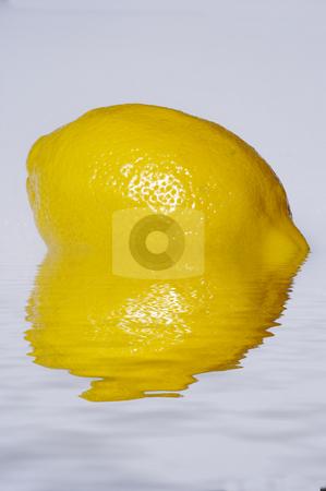 Yellow Lemon In Water stock photo, A single lemon reflected in calm water by Lynn Bendickson