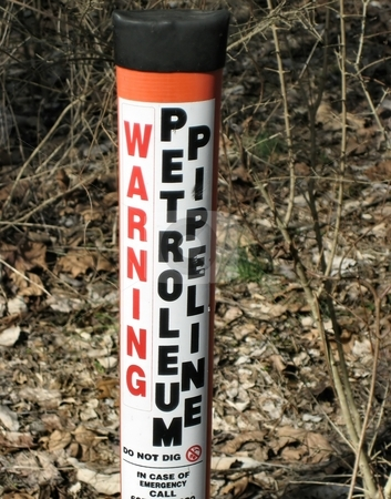 Warning stock photo, Warning sign for underground pipeline by Albert Lozano