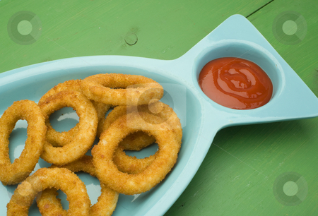 Onion rings stock photo, An order of onion rings with ketchup by Jonathan Hull