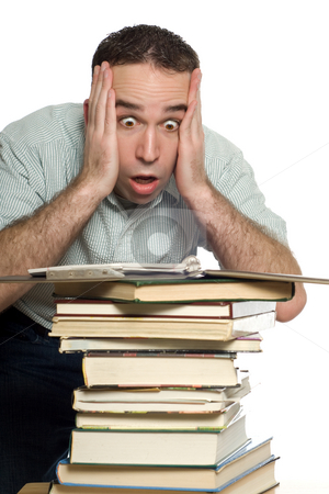 Frustrated Student stock photo, A frustrated student is shocked to see all the books he has to study, isolated against a white background by Richard Nelson