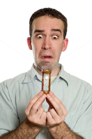 Running Out Of Time stock photo, Concept image of a man looking worried because he is running out of time, isolated against a white background by Richard Nelson