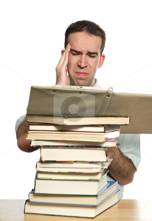 Study Headache stock photo, A college student suffering from a headache as he tries to study for a test by Richard Nelson
