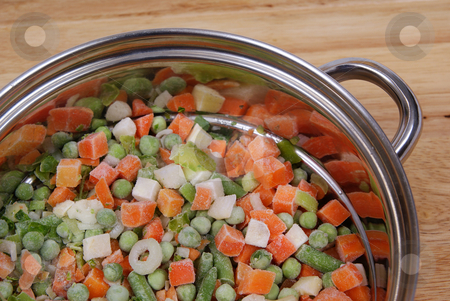 Frozen vegetables stock photo, Variable types of frozen vegetables in pot as background by Jolanta Dabrowska