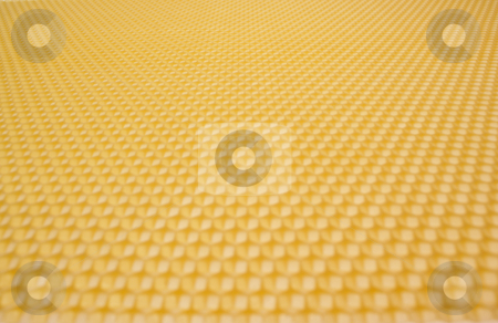 Beeswax stock photo, Close up structure of yellow beeswax as background by Jolanta Dabrowska