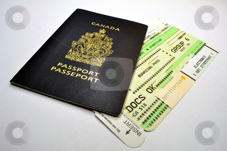 Passport and boarding pass stock photo, Canadian passport and air travel boarding pass by Fernando Barozza