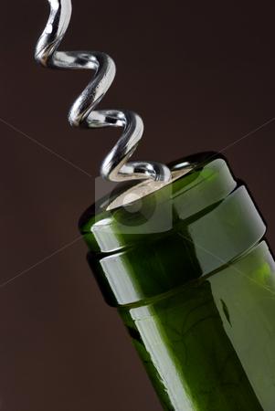 Uncorking stock photo, Macro close up of corkscrew in wine bottle cork by Paul Turner