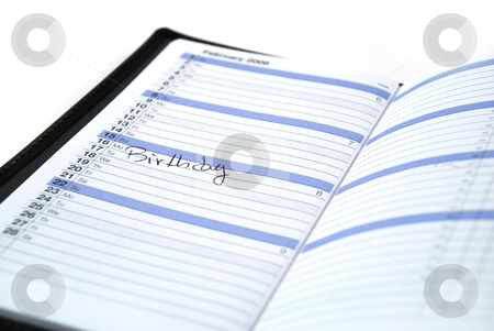 Birthday reminder stock photo, Daily planner showing a birthday reminder in the month by Albert Lozano