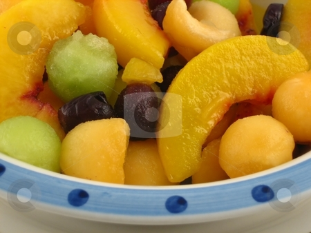 Fruit salad stock photo, Bowl with different healthy and nutritious fruits by Albert Lozano