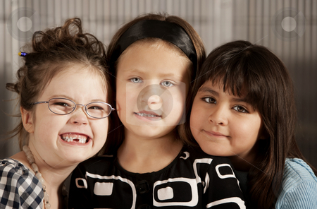 Three Young Friends stock photo, Portrait of three cute young elementery school girls by Scott Griessel