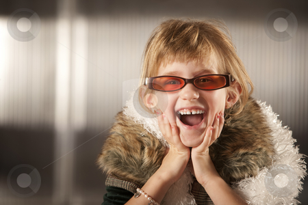 Cute young girl in red glasses stock photo, Cute young girl in dress-up clothes and red sunglasses by Scott Griessel