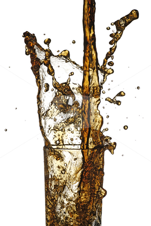 Cola splash stock photo, Cola being poured in to a glass from a height by Paul Turner