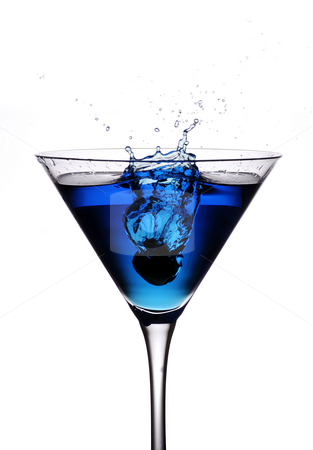 Cocktail olive splash stock photo, An olive being droped from height into a blue cocktail by Paul Turner