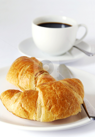 Croissants and coffee stock photo, Continental breakfast of coffee and croissants by Paul Turner
