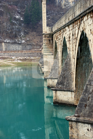 Famous Bridge on Drina stock photo, The bridge on the Drina in Visegrad in Bosnia and Herzegovina on a winter day. by Ivan Paunovic