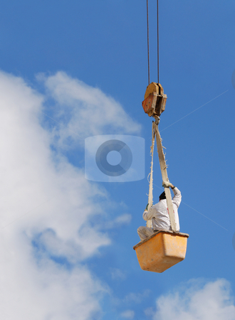 Worker in air stock photo, A worker hanging on a steel cable. by Ivan Paunovic