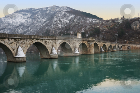 Famous Bridge on Drina stock photo, The bridge on the Drina in Visegrad in Bosnia and Herzegovina in twilight. by Ivan Paunovic