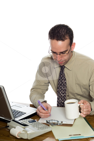 Working Accountant stock photo, A young accountant doing some work at his desk, isolated against a white background by Richard Nelson