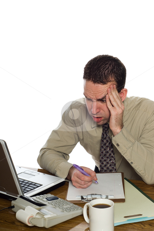 Confused Accountant stock photo, A confused accountant looking at his recent calculation, isolated against a white background by Richard Nelson