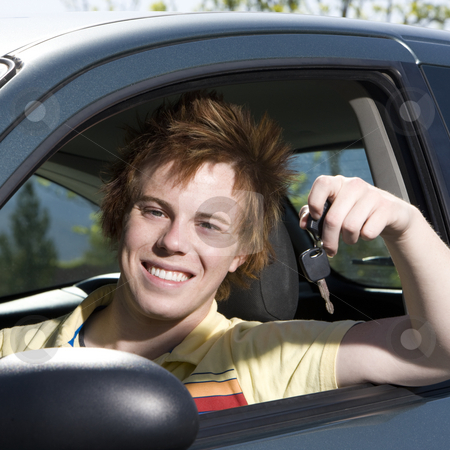 Happy teen in car stock photo, Happy teen with keys to car smiles by Rick Becker-Leckrone