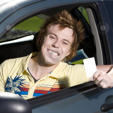 Happy teen in car stock photo, Happy teen with driver's licence smiles proudly by Rick Becker-Leckrone