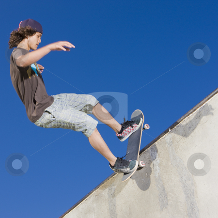 Skateboard tricks stock photo, Teen boy does tricks in the half pipe at a skate park by Rick Becker-Leckrone